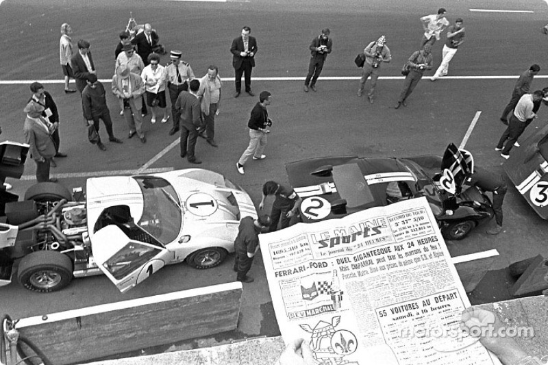 Ford GT-40 team in the Le Mans pits, 1966: Ken Miles and Denny Hulme (1) finished second; Bruce McLaren and Chris Amon (2) won; Dick Hutcherson and Ronnie Bucknum (5) finished third