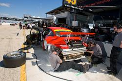 Flying Lizard Motorsports team member at work