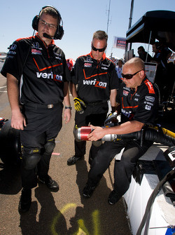 Team Penske team members check the new refueling safety interlock system