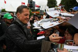 Michael Schumacher, Mercedes GP Petronas F1 Team signs an autograph