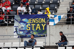 Fans in the grandstand and a banner for Jenson Button, McLaren