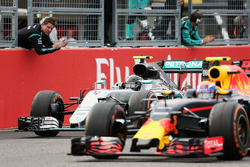 Race winner Nico Rosberg, Mercedes AMG F1 W07 Hybrid celebrates at the end of the race as he passed by Max Verstappen, Red Bull Racing RB12