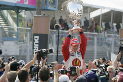 Race winner and Champ Car World Series 2005 champion Sébastien Bourdais celebrates with the Vanderbilt Cup