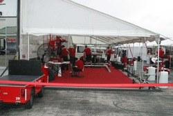 With no garages, teams work under tents