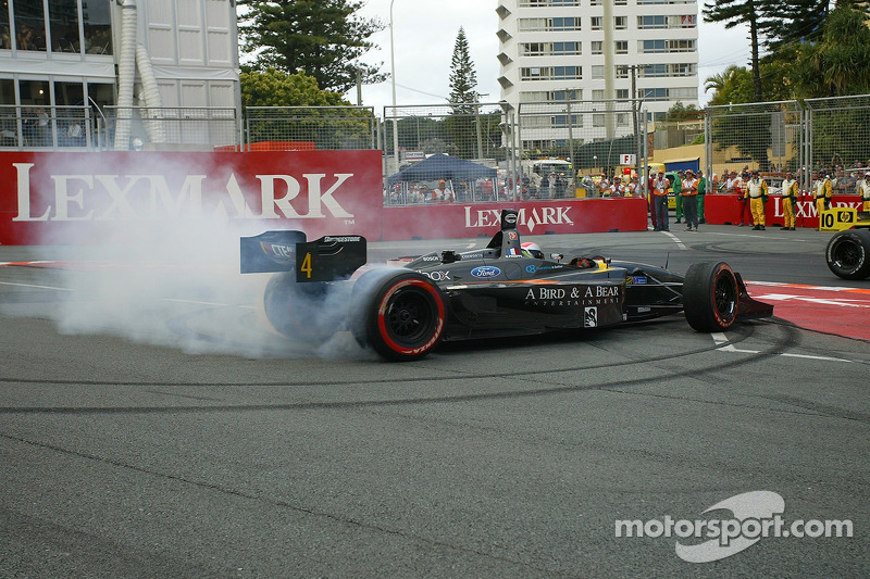Nelson Philippe performs celebratory donuts after winning the 2006 Lexmark Indy 300