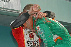 Victory lane: race winner Dan Wheldon celebrates with Tony Kanaan