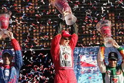 Podium: race winner Dan Wheldon with Tony Kanaan and Dario Franchitti