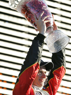 Podium: race winner Dan Wheldon celebrates