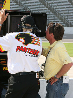 Scott Goodyear and a Team Panther member look at qualifying times