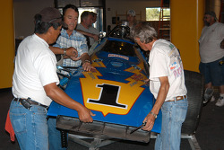 Board member Gerald Sexson assists property manager Lee Gonzales and former Galles crew chief Martin Fox in reassembling Johnny Lightning Special nose cone