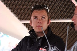 Dan Wheldon watches the rain fall