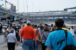 People - mostly fans - crowd pit road