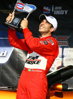 Pole winner Helio Castroneves with the pole award trophy