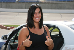 A lovely fans gives the thumbs up after riding in the pace car