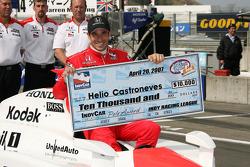 Pole winner Helio Castroneves celebrates