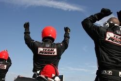 Team Penske crew members celebrate win