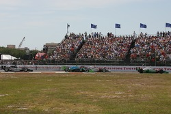 Tony Kanaan leads a group of cars