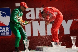 Podium: champagne for Helio Castroneves and Tony Kanaan