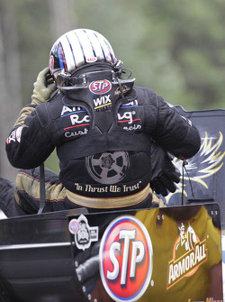 Tony Pedregon emerging from his Chevy Impala after being defeated by his brother Cruz Pedregon during round two of eliminations at the Southern Nationals