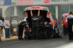 Matt Hagan's team tends to the car after the burnout