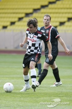 Fernando Alonso showing his soccer skills on Wednesday