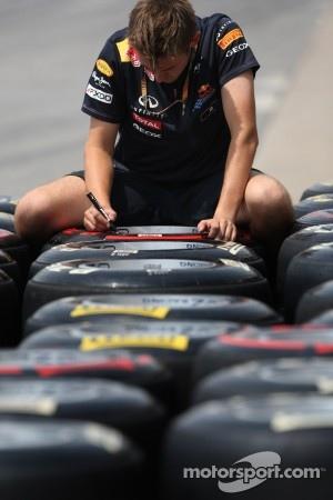 Red Bull Racing mechanic works on Pirelli Tires