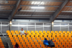 Spectators sleep in the stands in the early morning hours