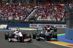 Sergio Pérez, Sauber F1 Team and Michael Schumacher, Mercedes GP Petronas