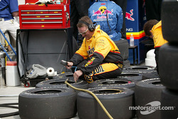 Panther Racing crew member checks tire pressure