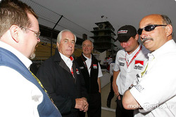 Roger Penske and Bobby Rahal discuss with friends
