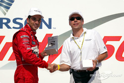 Race winner Helio Castroneves receives Maurice Lacroix watch