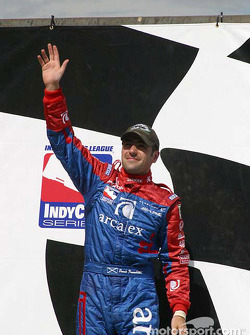 Dario Franchitti waves to the crowd from Victory Lane
