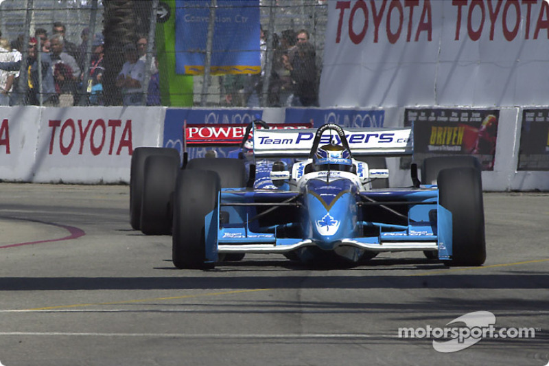 Patrick Carpentier chased by Scott Dixon