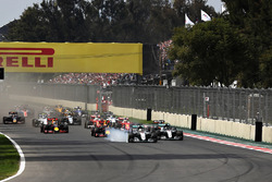 Lewis Hamilton, Mercedes AMG F1 W07 Hybrid locks a wheel under braking into turn one ahead of Max Verstappen, Red Bull Racing RB12 and Nico Rosberg, Mercedes AMG F1 W07 Hybrid
