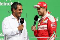 Juan Pablo Montoya, con el podio con Sebastian Vettel, Ferrari