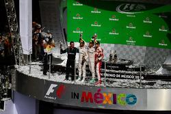 The podium (L to R): Tony Walton, Mercedes AMG F1 Mechanic; Nico Rosberg, Mercedes AMG F1, second; Lewis Hamilton, Mercedes AMG F1, race winner; Sebastian Vettel, Ferrari, third