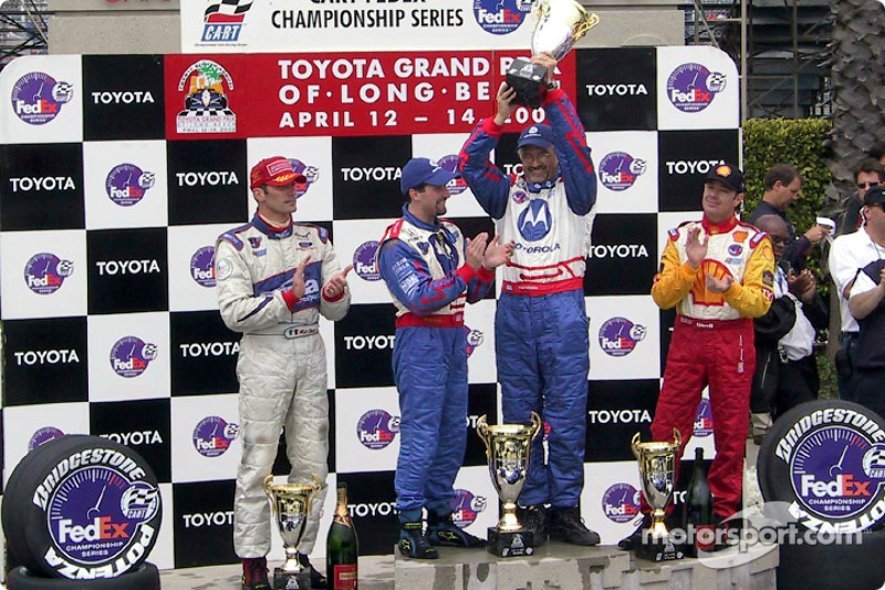 Le podium : le vainqueur Michael Andretti avec Jimmy Vasser et Max Papis