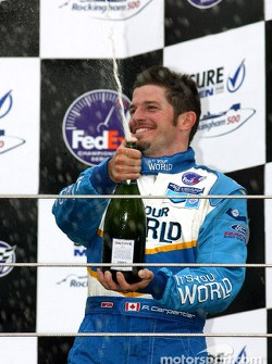The podium: champagne for Patrick Carpentier
