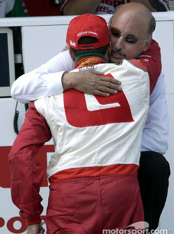 Team owner Bobby Rahal comforts Michel Jourdain Jr. after a  mechanical failure