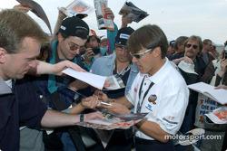 Adrian Fernandez signs autographs