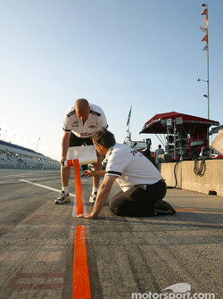 Newman-Haas team members prepare the pitstop marks