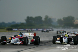 Sébastien Bourdais in front of Bruno Junqueira
