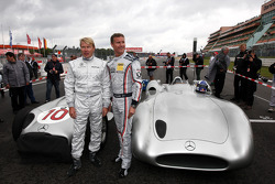 Mika Hakkinen drives the Mercedes GP drives the 1955 Mercedes W196 and David Coulthard, Red Bull Racing, Consultant drives the Mercedes 1955