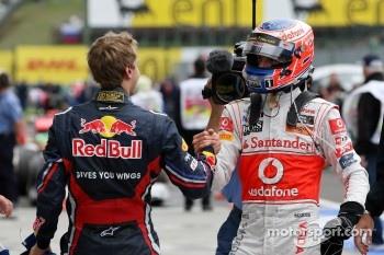 Race winner Jenson Button, McLaren Mercedes celebrates with Sebastian Vettel, Red Bull Racing