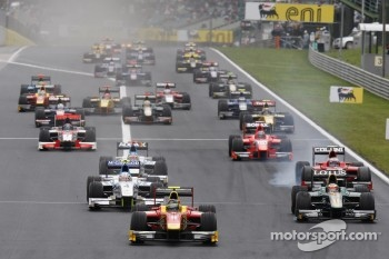 Christian Vietoris leads Jules Bianchi, Giedo Van der Garde and the rest of the field into turn one on the opening lap of the race