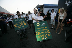 The team take Valtteri Bottas on a victory lap of the paddock after winning the drivers and teams championship