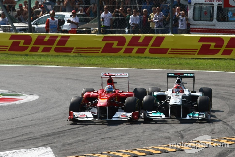 Fernando Alonso, Scuderia Ferrari and Michael Schumacher, Mercedes GP F1 Team