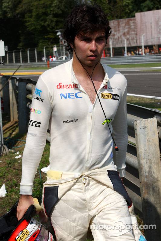 Sergio Perez, Sauber F1 Team walks back after stopping on track