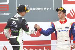 Antonio Felix Da Costa celebrates victory on the podium with Nico Muller