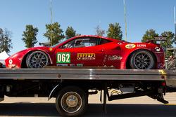 Damaged #062 Risi Competizione Ferrari F458 Italia sits on pitlane during pre-race ceremony